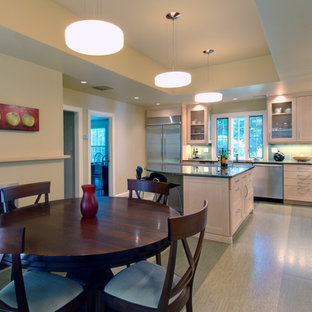 Inspiration for a large traditional l-shaped kitchen/diner in Boston with a submerged sink, recessed-panel cabinets, white cabinets, granite worktops, green splashback, glass tiled splashback, stainless steel appliances, cork flooring and an island.