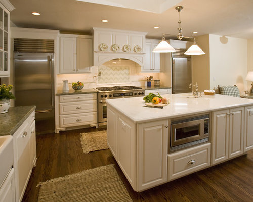 Captivating Example Of A Classic Enclosed Kitchen Design In San Francisco With  Raised Panel Cabinets,