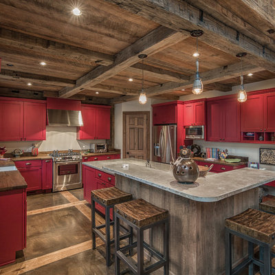 Open concept kitchen - mid-sized rustic u-shaped concrete floor open concept kitchen idea in Charlotte with a single-bowl sink, shaker cabinets, red cabinets, granite countertops, white backsplash, stainless steel appliances and an island