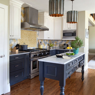 Kitchen - mid-sized traditional dark wood floor and brown floor kitchen idea in Denver with recessed-panel cabinets, multicolored backsplash, an island, blue cabinets, marble countertops, ceramic backsplash and stainless steel appliances