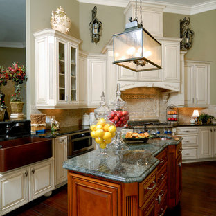 Traditional eat-in kitchen ideas - Example of a classic l-shaped dark wood floor and brown floor eat-in kitchen design in Orlando with an undermount sink, raised-panel cabinets, white cabinets, granite countertops, red backsplash, brick backsplash, stainless steel appliances and two islands