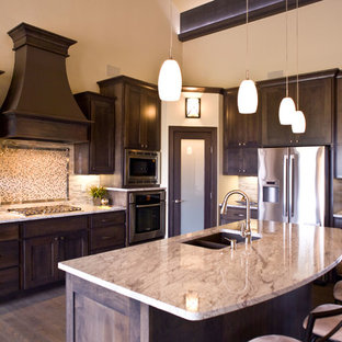 Mid-sized transitional open concept kitchen ideas - Mid-sized transitional l-shaped dark wood floor and brown floor open concept kitchen photo in Other with an undermount sink, dark wood cabinets, multicolored backsplash, stainless steel appliances, an island, raised-panel cabinets, granite countertops and mosaic tile backsplash