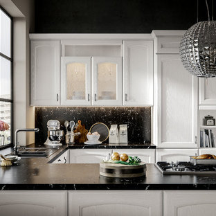 Design ideas for a mid-sized traditional galley eat-in kitchen in San Diego with an integrated sink, beaded inset cabinets, white cabinets, quartzite benchtops, black splashback, slate splashback, white appliances, light hardwood floors and brown floor.