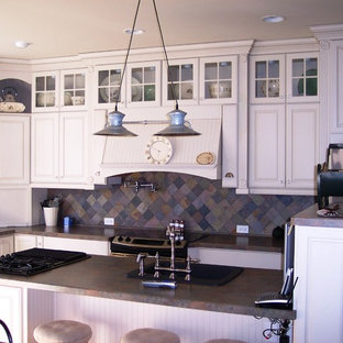Inspiration for a mid-sized country l-shaped separate kitchen in Nashville with a drop-in sink, raised-panel cabinets, white cabinets, granite benchtops, multi-coloured splashback, slate splashback, stainless steel appliances and with island.