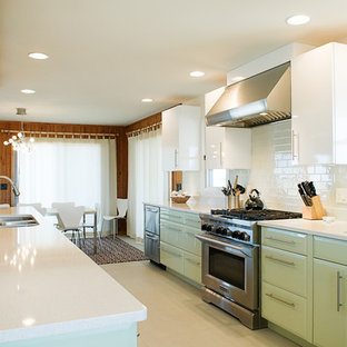 Design ideas for a contemporary eat-in kitchen in Other with subway tile splashback, a triple-bowl sink, green cabinets, quartz benchtops, white splashback, stainless steel appliances and flat-panel cabinets.