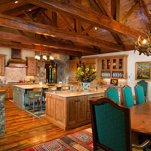 Inspiration for a timeless kitchen remodel in Denver with raised-panel cabinets, medium tone wood cabinets and beige backsplash