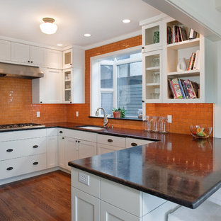 Photo of a contemporary kitchen in Seattle with shaker cabinets, white cabinets, orange splashback, subway tile splashback and a single-bowl sink.