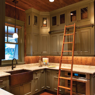 Photo of a mid-sized country u-shaped separate kitchen in Detroit with a farmhouse sink, louvered cabinets, green cabinets, granite benchtops, brown splashback, stainless steel appliances, medium hardwood floors, timber splashback and no island.