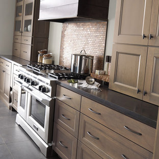 Large transitional kitchen ideas - Kitchen - large transitional galley slate floor kitchen idea in Other with an undermount sink, shaker cabinets, brown cabinets, quartz countertops, beige backsplash, mosaic tile backsplash, stainless steel appliances and an island