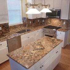 Traditional Kitchen by Granite Countertops by Mogastone
