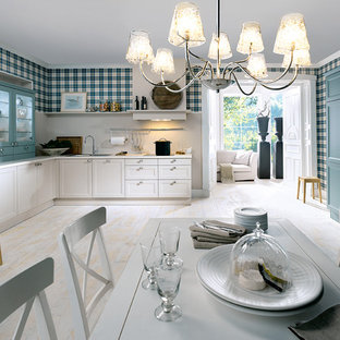 Inspiration for a large traditional eat-in kitchen in Other with light hardwood floors.