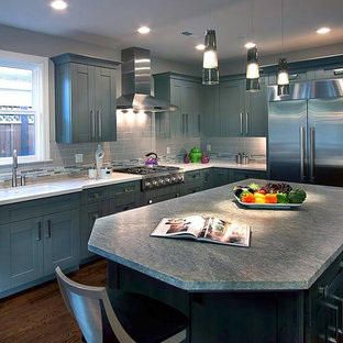 Mid-sized transitional kitchen ideas - Inspiration for a mid-sized transitional u-shaped dark wood floor kitchen remodel in San Francisco with an undermount sink, shaker cabinets, blue cabinets, granite countertops, gray backsplash, matchstick tile backsplash, stainless steel appliances and an island