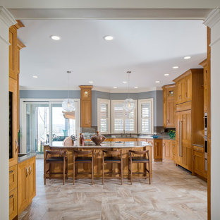 Design ideas for a large transitional l-shaped open plan kitchen in Atlanta with an undermount sink, flat-panel cabinets, light wood cabinets, quartzite benchtops, brown splashback, slate splashback, panelled appliances, porcelain floors, with island and brown floor.