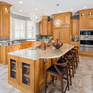 This is an example of a large transitional l-shaped open plan kitchen in Atlanta with an undermount sink, flat-panel cabinets, light wood cabinets, quartzite benchtops, brown splashback, slate splashback, panelled appliances, porcelain floors, with island and brown floor.