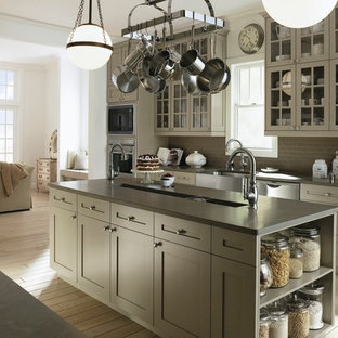 Photo of a traditional u-shaped open plan kitchen in Milwaukee with a farmhouse sink, open cabinets, beige cabinets, quartzite benchtops, grey splashback, subway tile splashback and stainless steel appliances.