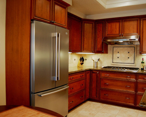 red kitchen pantry with stainless steel appliances design