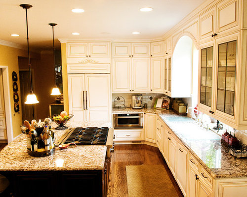 Mid-sized traditional u-shaped medium tone wood floor and brown floor eat- - Antique Kitchen Cabinet Houzz