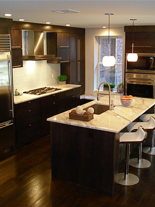 Inspiration For A Contemporary Galley Kitchen Remodel In Boston With Stainless Steel Appliances Marble Countertops