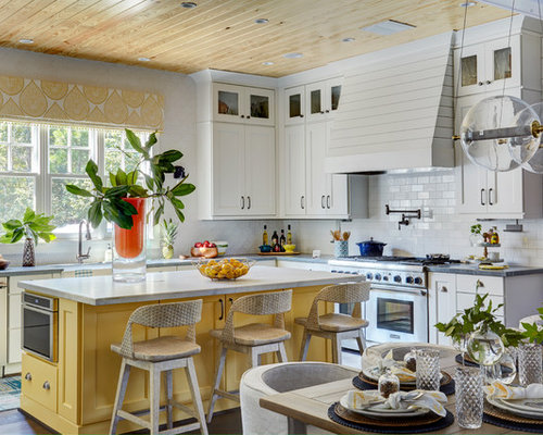 yellow kitchen cabinets. Farmhouse eat in kitchen appliance  Example of a country l shaped medium tone Yellow Kitchen Cabinets Houzz