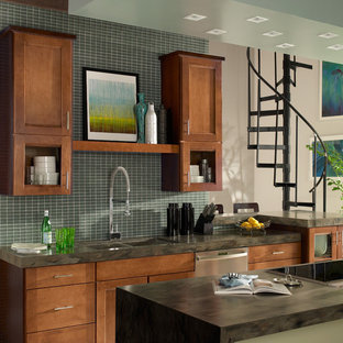 Mid-sized transitional kitchen photo in Other with a double-bowl sink, recessed-panel cabinets, medium tone wood cabinets, green backsplash, glass tile backsplash, stainless steel appliances and an island