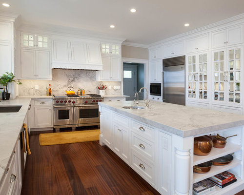 Panel cabinets white cabinets dark hardwood floors and an island