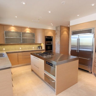 Photo of a mid-sized modern u-shaped separate kitchen in Orange County with a triple-bowl sink, flat-panel cabinets, light wood cabinets, granite benchtops, stainless steel appliances, marble floors and with island.