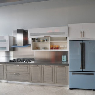 Large modern single-wall eat-in kitchen in Orange County with open cabinets, white cabinets, quartz benchtops, metallic splashback, metal splashback, coloured appliances and limestone floors.