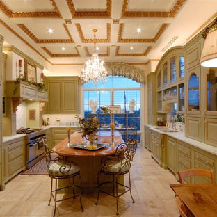 Large shabby-chic style eat-in kitchen ideas - Large cottage chic galley ceramic floor eat-in kitchen photo in Los Angeles with a double-bowl sink, raised-panel cabinets, light wood cabinets, marble countertops, stainless steel appliances and an island