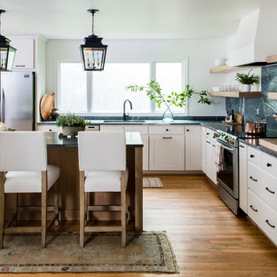 Design ideas for a large country l-shaped open plan kitchen in DC Metro with an undermount sink, shaker cabinets, light wood cabinets, soapstone benchtops, green splashback, stone slab splashback, stainless steel appliances, with island, green benchtop, brown floor and medium hardwood floors.