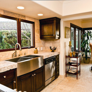 Photo of a large mediterranean u-shaped eat-in kitchen in New York with a farmhouse sink, open cabinets, beige cabinets, limestone benchtops, beige splashback, stone tile splashback, white appliances, limestone floors and with island.