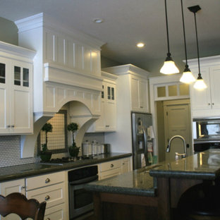 Large traditional eat-in kitchen pictures - Eat-in kitchen - large traditional l-shaped eat-in kitchen idea in Salt Lake City with an undermount sink, shaker cabinets, white cabinets, granite countertops, gray backsplash, ceramic backsplash, stainless steel appliances, an island and black countertops