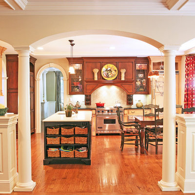Elegant eat-in kitchen photo in Other with medium tone wood cabinets and stainless steel appliances