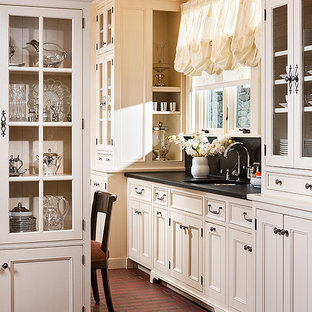 Medium sized rural l-shaped kitchen/diner in Other with a double-bowl sink, recessed-panel cabinets, white cabinets, soapstone worktops, white splashback, ceramic splashback, stainless steel appliances, brick flooring and an island.
