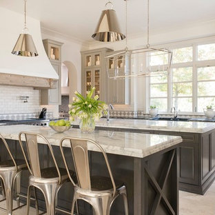 Traditional l-shaped kitchen in Dallas with recessed-panel cabinets, beige cabinets, white splashback, subway tile splashback, multiple islands and beige floor.