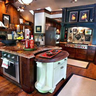 Large rustic eat-in kitchen ideas - Eat-in kitchen - large rustic l-shaped dark wood floor and brown floor eat-in kitchen idea in Indianapolis with a farmhouse sink, recessed-panel cabinets, dark wood cabinets, granite countertops, stainless steel appliances, an island and red countertops
