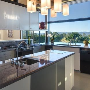 Inspiration for a mid-sized midcentury u-shaped eat-in kitchen in Los Angeles with an undermount sink, flat-panel cabinets, stainless steel appliances, brown benchtop, white cabinets, granite benchtops, brown splashback, stone slab splashback and with island.