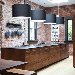 Imagen de cocina de galera, contemporánea, con fregadero bajoencimera, armarios con paneles lisos y puertas de armario de madera oscura