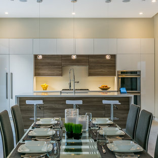 Inspiration for a modern eat-in kitchen in Los Angeles with a double-bowl sink, open cabinets, white cabinets, quartz benchtops, white splashback, stainless steel appliances, porcelain floors and with island.