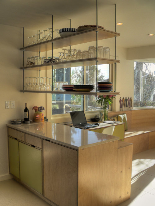 Example of a midcentury modern kitchen design in Denver with open cabinets  and light wood cabinets