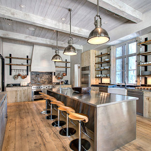 Contemporary enclosed kitchen appliance - Example of a trendy enclosed kitchen design in Houston with stainless steel appliances, a farmhouse sink, flat-panel cabinets, medium tone wood cabinets and stainless steel countertops