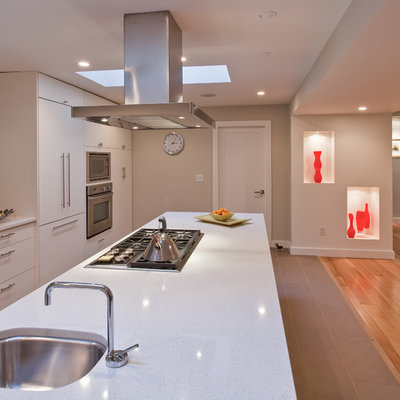 Trendy open concept kitchen photo in Vancouver with stainless steel appliances, an undermount sink, flat-panel cabinets, white cabinets, multicolored backsplash and mosaic tile backsplash