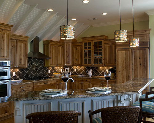 Example Of A Classic Kitchen Design In Raleigh With Granite Countertops,  Raised Panel Cabinets