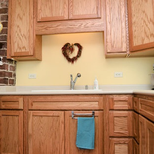 Inspiration for a mid-sized transitional u-shaped separate kitchen in Other with a drop-in sink, recessed-panel cabinets, light wood cabinets, laminate benchtops, white appliances, laminate floors, no island, brown floor and beige benchtop.