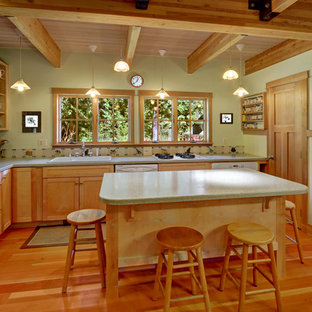 Photo of a mid-sized country l-shaped eat-in kitchen in Seattle with a double-bowl sink, open cabinets, medium wood cabinets, white appliances, medium hardwood floors and with island.
