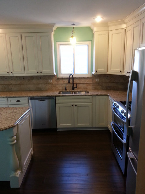 Kraftmaid Cabinets done in Harrington Door Style Maple Wood Finsihed in a Canvas