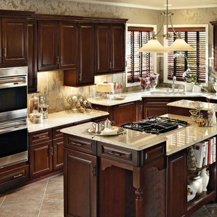 Example of a mid-sized classic l-shaped eat-in kitchen design in Detroit with medium tone wood cabinets and an island