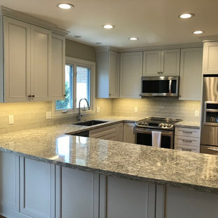 This is an example of a mid-sized transitional u-shaped open plan kitchen in Other with an undermount sink, recessed-panel cabinets, white cabinets, quartz benchtops, stainless steel appliances, medium hardwood floors and green benchtop.