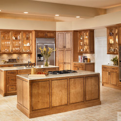 KraftMaid Cabinetry: Maple Square Raised Door in Praline with Mocha Highlight - Lighted cabinets ...