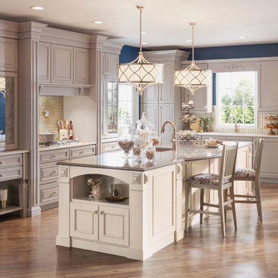 Mid-sized transitional l-shaped eat-in kitchen photo in Detroit with raised-panel cabinets, gray cabinets and an island