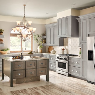 Design ideas for a large transitional l-shaped open plan kitchen in Detroit with a farmhouse sink, beaded inset cabinets, grey cabinets, granite benchtops, white splashback, stainless steel appliances, vinyl floors, with island, brown floor and grey benchtop.